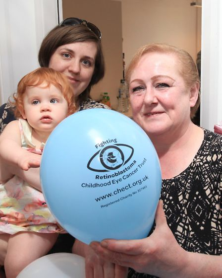 Cathy Woodstock with daughter Kitty and mother Myra Sultana at the opening of the new Childhood Eye Cancer Trust office in...