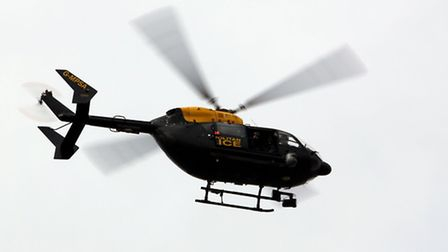 A police helicopter hovers over The Chase, Dagenham, where Neill's leg was found on April 1. Picture: Ellie Hoskins