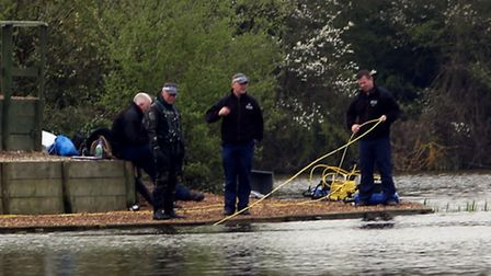 Police dredging White Hart Lakes in Eastbrookend Country Park, off The Chase, Dagenham, where Neill's leg was discovered...