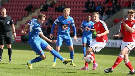 O's Ryan Hedges gets a shot in against Crewe Alexandra(pic: Simon O'Connor/TGSPHOTO).