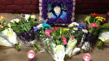 Memorial of flowers at spot where Wayne Stockdale was gunned down in 2011 at Bromley-by-Bow