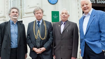 In front of the blue plaque are, from left, Michael Loveday of Norwich HEART, Sheriff Graham Creelma