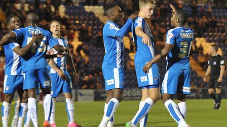 Colchester United players are all smiles while celebrating Marvin Sordell's goal which wrapped up a 2-0 win over Bradford...