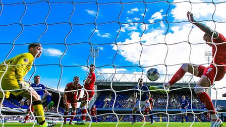 Luke Chambers scores Town's opener despite the efforts of Aden Flint to clear.Ipswich Town v Bristol City...