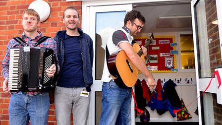 Students, staff and villagers along with folk band The Young'uns open the new classroom at Snape Primary School.