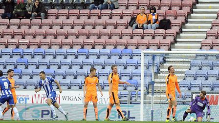 Despondent U's players after Donervan Daniels scores the opening goal for Wigan in their 5-0 win on Saturday