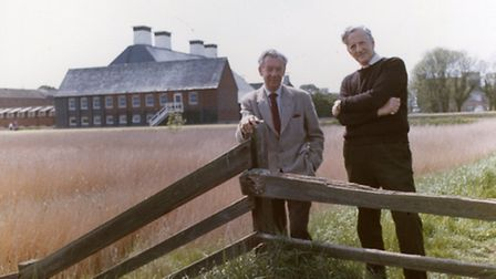 Benjamin Britten and Peter Pears walking in Snape's marshy landscape with the recently completed Snape Maltings Concert...