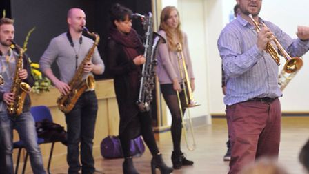 National Youth Jazz Orchestra musical director Mark Armstrong works with pupils at Ipswich School Festival of Music