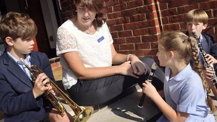 Music director Bev Steensma works with pupils at Ipswich School Festival of Music.