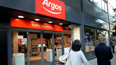 Argos owner Home Retail warned over full-year profits after first half earnings nearly halved at the high street chain...