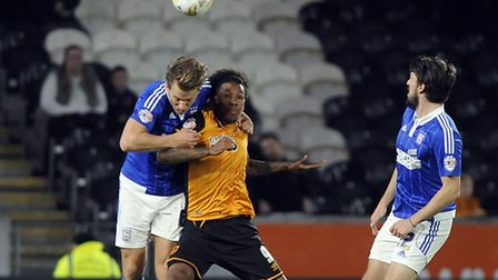 Christophe Berra tries to get to grips with Hull's Chuba Akpom