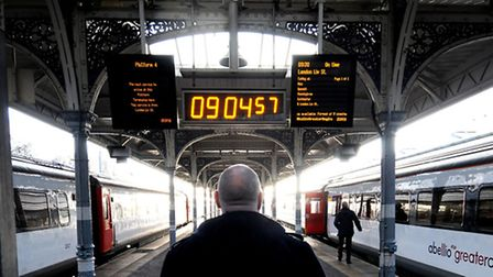 A passenger waits at Norwich Train Station. Picture: ANTONY KELLY