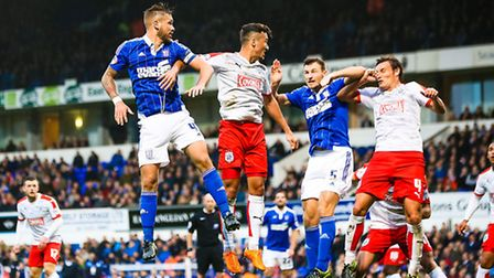 Luke Chambers and Tommy Smith battle in the air with Jason Davidson and Dean Whitehead during the second half of the...