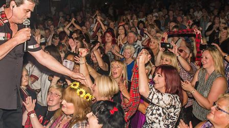 The Bay City Rollers' Les McKeown performs for the Tartan Army