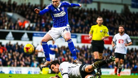 Freddie Sears tries to get on the ball after his shot was blocked by George Thorne during the Ipswich Town v Derby County...