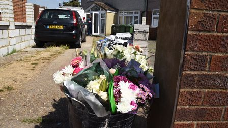 Floral tributes left outside the house in Valentines Way Rush Green.