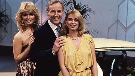 """NICHOLAS PARSONS WITH HOSTESSES ON """"THE SALE OF THE CENTURY'."""