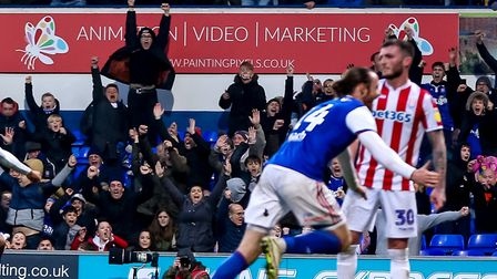 Fans on the terraces go wild as Will Keane wheels away, after scoring a late equaliser for Ipswich Town in their 1-1 draw...