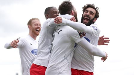 Mitch Brundle of Dagenham scores the first goal for his team and celebrates with his team mates during Dagenham &...