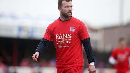 Mitch Brundle of Dagenham wears a Fans for Diversity t-shirt during the warm up ahead of Dagenham & Redbridge vs Solihull...