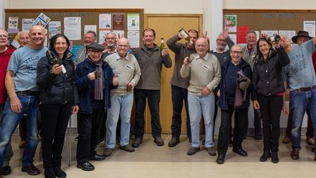 Members of Dereham Men's Shed, creatively photographed in 2019.