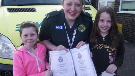 Two sisters have been given a commendation by the ambulance service after calling 999 when their mum