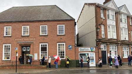 Queues of people outside of Thetford post office.