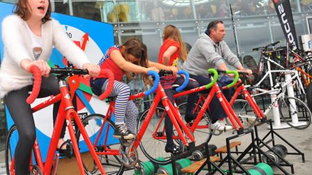 Visitors to Norfolk Cycle Show getting into the saddle outside the Forum, Norwich. Photo: Steve Adam