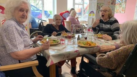 Burgh House care home residents enjoying their pizza party earlier this month. Photo: Francesca Corn