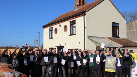 Trades people and supporters of the project which restored the cottage for Norwich City Community Sports Foundationhub on...
