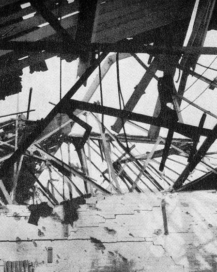 Wrecked roof trusses and shrapnel-scarred walls at the CWS in Lowestoft in the wake of the raid.