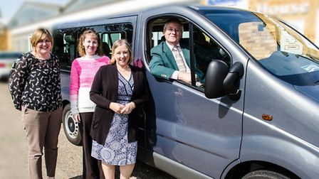 Members of the BACT team with the new wheelchair accessible vehicle.