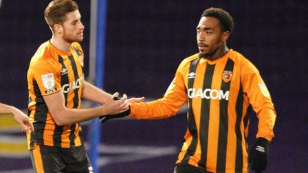 Mallik Wilks (right) is congratulated by teammate Reece Burke, after giving the visitors an early lead.Picture...