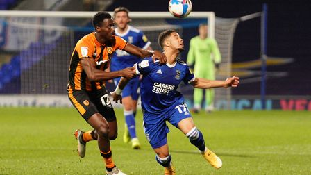Keanan Bennetts is held back by Josh Emmanuel as he tries to get his heads to the ball. Picture: Steve Waller...