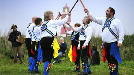 The Weavers Morris dance in the first sunrise of May on Happisburgh cliffs.PHOTO: ANTONY KELLY