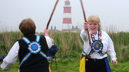 The Weavers Morris dance in the first sunrise of May on Happisburgh cliffs. Left, Ann Brown and Jan