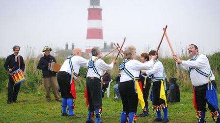 The Weavers Morris dance in the first sunrise of May on Happisburgh cliffs. PHOTO: ANTONY KELLY