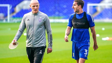 Town fitness coach Jim Henry out on the pitch with a non playing Stephen Ward ahead of the Arsenal game. Picture...