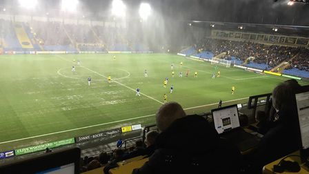 The wet and windy conditions under the floodlights, as pictured from the press box, during Town's visit to the Kassam...