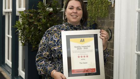 An emotional Liliane Aubourg, general manager at the Swan Hotel, with her AA award Picture: ANTHONY CULLEN