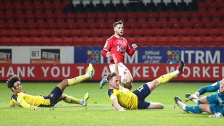Charlton Athletic's Conor Washington (centre) scores against Oxford United during last month's 2-0 win. Washiington has...