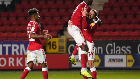 Happy days at The Valley: Charlton Athletic's Conor Washington (right) celebrates scoring in the 3-2 win over Fleetwood...