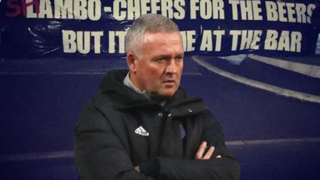 Ipswich Town manager Paul Lambert has responded to the banner left at Playford Road by the Blue Action fans group.
