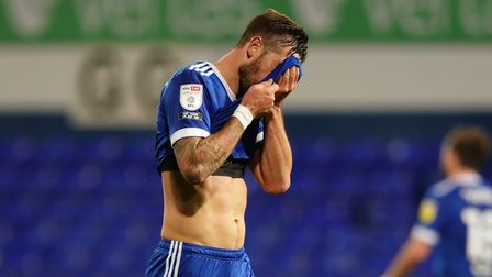 Ipswich Town skipper Luke Chambers reacts to anothe defeat to a promotion rival. Photo: Steve Waller