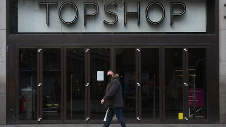 A man walks past the Topshop flagship store at Oxford Circus, London, part of the Arcadia Group. Picture: KIRSTY...