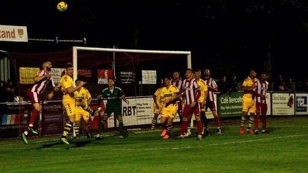 Isthmian League action between Felixstowe & Walton United (red and white) and AFC Sudbury, from earlier this season.