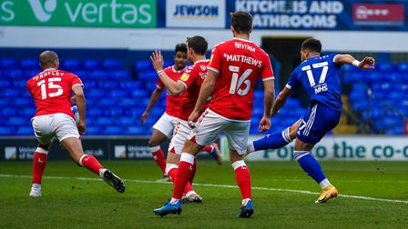 Town appealed for an early penalty after Keanan Bennetts shot appeared to hit the hand of Darren Pratley.Picture...