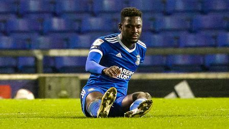 Toto Nsiala looks dejected as he sits on the pitch injured, just before going off.Picture: Steve Waller...