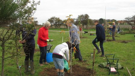 Volunteers from the Thorpeness Beach Baggers planting heritage fruit trees after a grant from the trust Picture: ADNAMS...