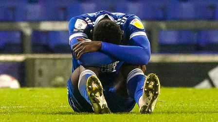 Toto Nsiala looks dejected as he sits on the pitch injured, just before going off. Picture: Steve Waller...